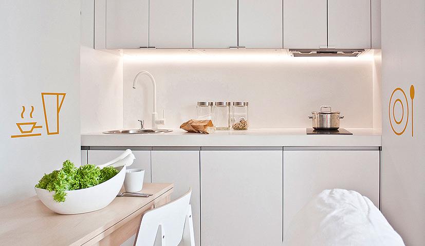 Mieszkanie z innowacją, czyli kuchnia schowana w szafie  klikinterior