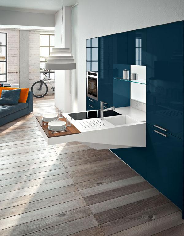 Jeśli chcesz nadać kuchni nowoczesny wygląd dodaj jakiś odważny kolor - czarny lub kolor kamieni szlachetnych. Kolor może być na blatach, frontach lub na ścianie.