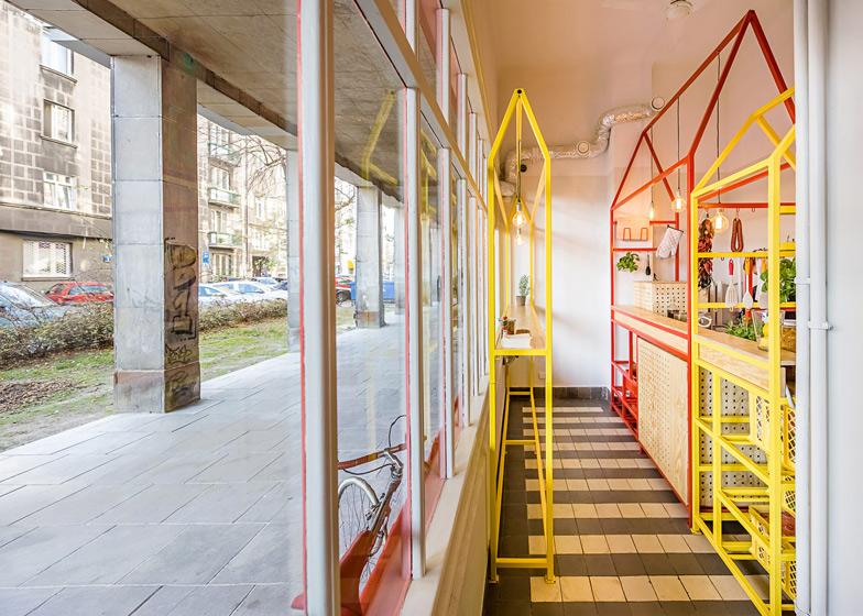 Zapiekanka-restaurant-in-Warsaw-with-painted-steel-frames-by-MFRMGR_dezeen_ss_1