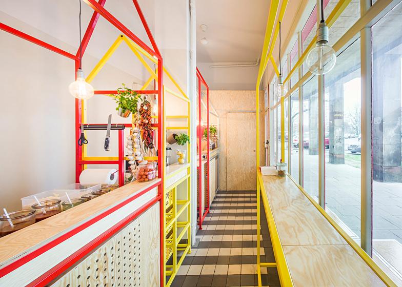Zapiekanka-restaurant-in-Warsaw-with-painted-steel-frames-by-MFRMGR_dezeen_ss_19