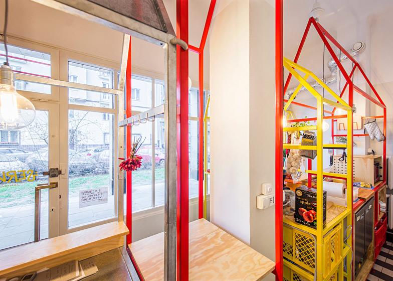 Zapiekanka-restaurant-in-Warsaw-with-painted-steel-frames-by-MFRMGR_dezeen_ss_20